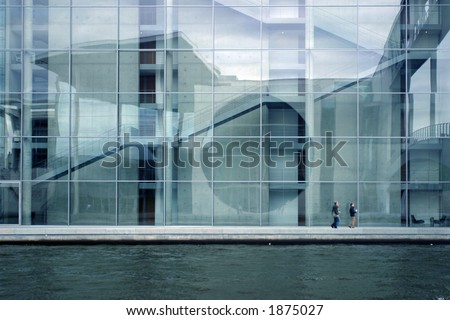 Modern building elevation at the water - stock photo