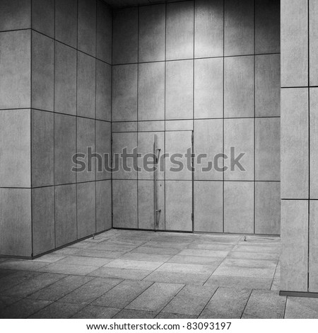 modern building exterior fragment, wall with door. - stock photo