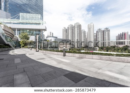 Modern building facade with empty cement road for copy space. - stock photo