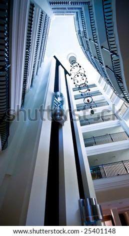 Modern building lift. Blue color - stock photo