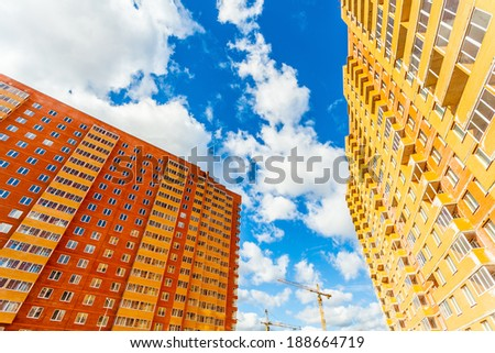 Modern building red and yellow walls perspective view - stock photo
