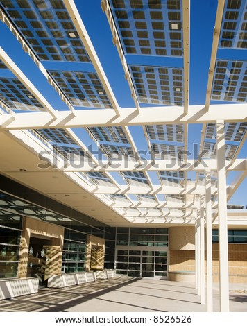 Modern building utilizing solar energy cells incoropated into the architecture - stock photo