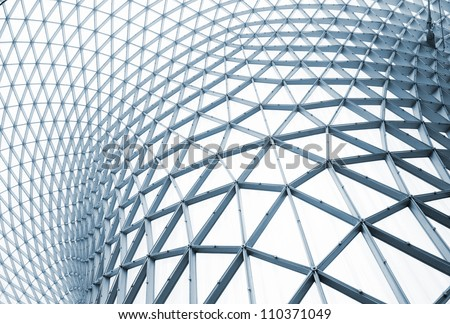 Modern building with curving roof and glass steel column. - stock photo