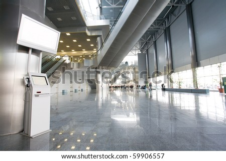 Modern building with informational terminal - stock photo