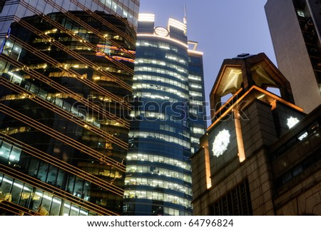 Modern building with skyscraper and tower in night in Hong Kong. - stock photo