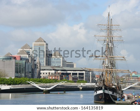 Modern buildings and tall ship in Dublin - Ireland.