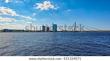 Modern buildings and Vansu Tilts or Vansu cable-stayed Bridge over the River Daugava, Riga, Latvia  - stock photo