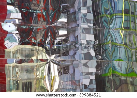 Modern buildings glass walls reflecting abstract distorted reflection
