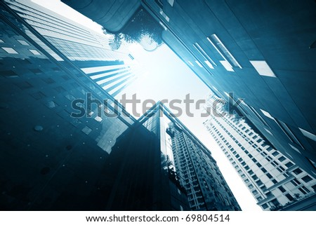 Modern buildings in downtown and blue sunlight - stock photo