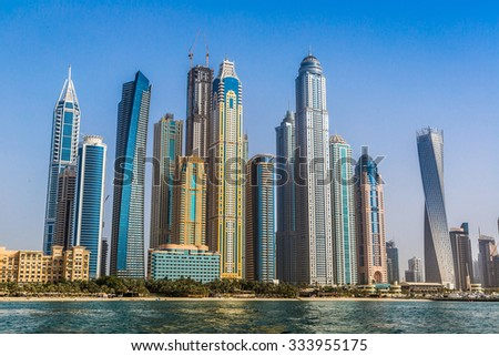Modern buildings in Dubai Marina, Dubai, UAE in a summer day - stock photo