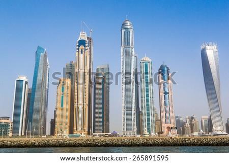 Modern buildings in Dubai Marina, Dubai, UAE. In the city of artificial channel length of 3 kilometers along the Persian Gulf,  - stock photo