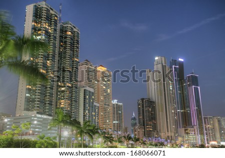 Modern buildings in Panama City with high skyscrapers in the sunset - stock photo