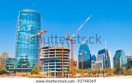 Modern buildings near construction site in Santiago de Chile - stock photo