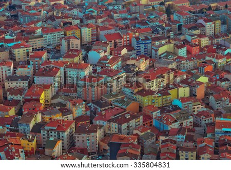 Modern buildings of the city - urban background for the city landscape concept. Colorful houses and rooftops of a big city.  Town roofs - architectural background of cityscape. - stock photo