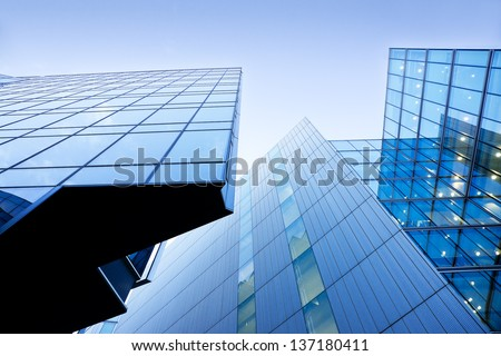Modern buildings, skyscrapers. Office buildings against the cloudy blue sky. Skyscrapers view with blue sky - stock photo
