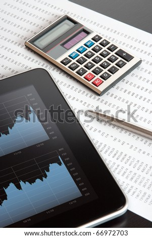 Modern business and stock market analyze with digital tablet, calculator, pen and printed data sheet