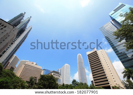 Modern business buildings with blue sky, shot in hong kong, asia - stock photo