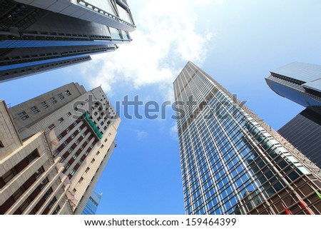 Modern business buildings with sun and sky, shot in hong kong, asia - stock photo