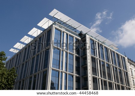 Modern business centre on blue sky with clouds - stock photo
