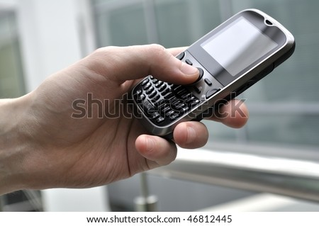 Modern business class smartphone in man hand. Adobe RGB color space. - stock photo