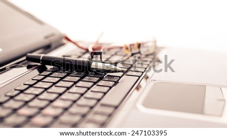 Modern business desk with laptop, pen and glasses. Modern business concepts - stock photo