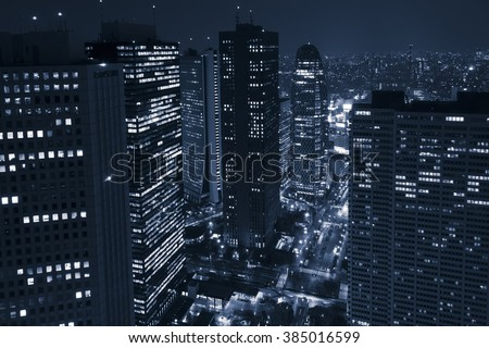 Modern business district with skyscrapers at night - stock photo