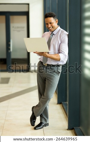 modern business man using laptop computer in office - stock photo