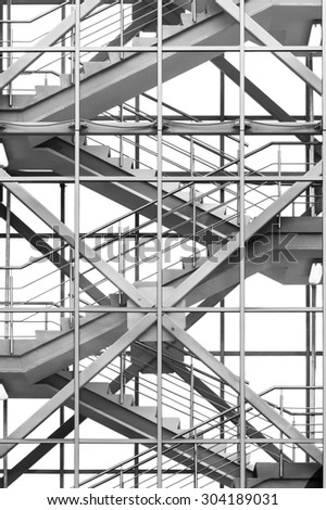 Modern business office stairs with steel handrail in new building with transparent glass walls, architectural geometric abstraction in monochrome  - stock photo
