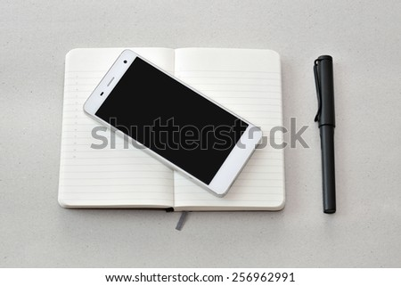 Modern business on the go- smart phone, notebook, and pen, isolated - stock photo