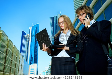 Modern business people are working together in the big city. - stock photo