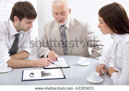 Modern business people discuss the new project - stock photo