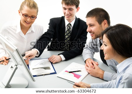 Modern business people working in the office - stock photo