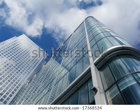 Modern business skyscraper in Canary Wharf, London. Skyscrapers are with clipping path. - stock photo
