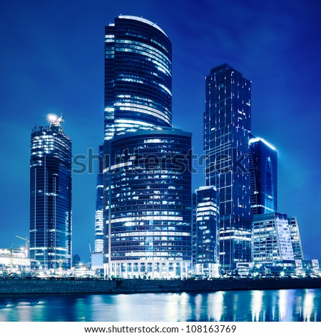 Modern business skyscrapers at night - stock photo