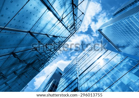 Modern business skyscrapers, high-rise buildings, architecture raising to the sky, sun. Concepts of financial, economics, future etc. - stock photo