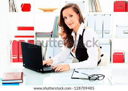 Modern business woman is working at the office. - stock photo