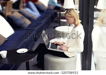 Modern business woman or young successful working on laptop computer while sitting at coffee shop interior, female student sitting in university library with net-book, internet distance work concept - stock photo