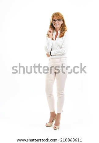 Modern business woman standing against white background.