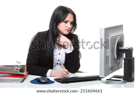 modern business woman working on laptop computer sitting at office desk isolated