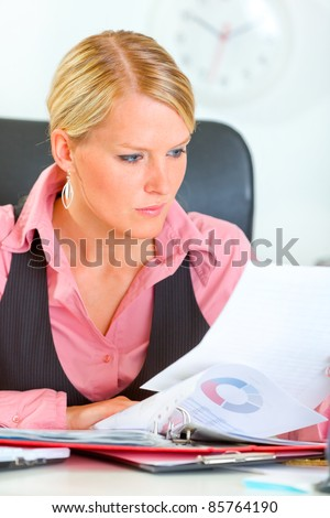 Modern business woman working with documents and checking records - stock photo