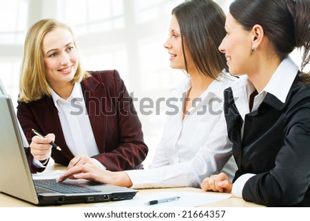 Modern business women discuss the project - stock photo