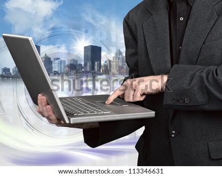 Modern Business World, A businessman looking at laptop - stock photo