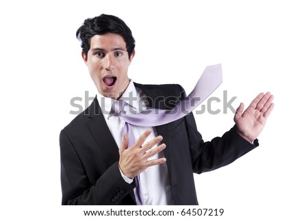 Modern businessman presenting something at the copy space with his necktie flying in that direction (isolated on white) - stock photo
