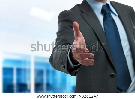 Modern businessman ready to handshake - stock photo