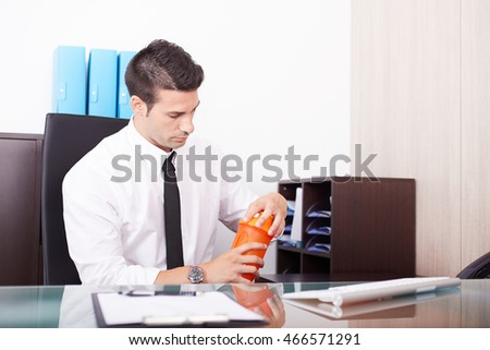 modern businessman shaking and drinking  protein drink after gym training