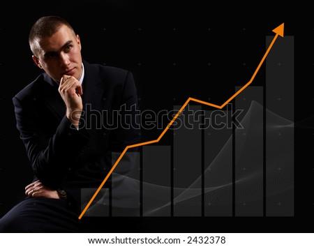 Modern Businessman watching finance chart rising - stock photo