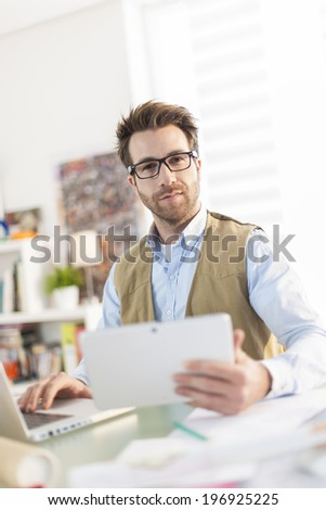 modern businessman working on his laptop at office - stock photo