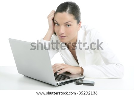 Modern businesswoman with white suit and laptop computer