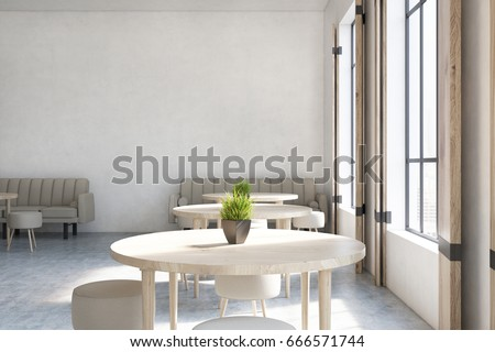 modern cafe interior with concrete walls wooden floor round tables and chairs and beige - Concrete Cafe Interior
