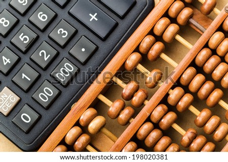 Modern calculator and abacus  - stock photo